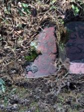 What is left of the red sandstone Gravestone of Mark Stratton B. 1692 D. 1759